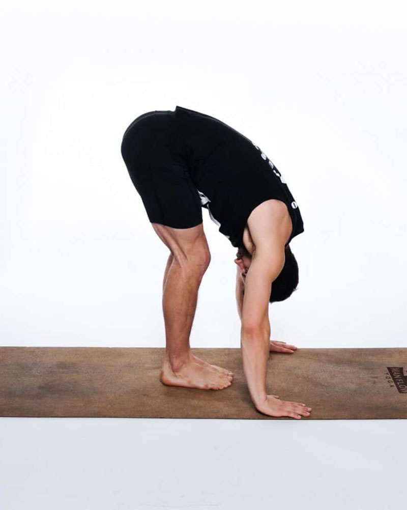 Forward fold pose helps to reduce back pain for men