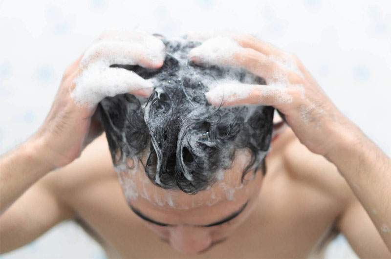 Less shampooing helps to get rid of frizzyness in hair